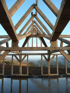 Internal view of oak frame roof 'shard'. By Roderick James Architects | Carpenter Oak