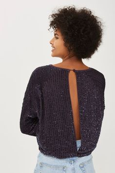 Perfect for party season, this purple sequin top features a batwing sleeve and cut out at the back. Wear it with denim separates to seamlessly take you from day to night.