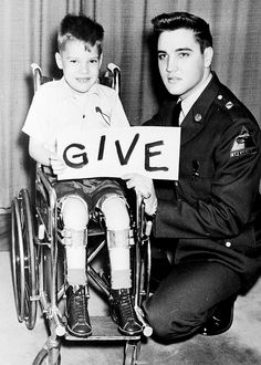 Elvis and polio victim Robert Stephen Marquette, in a March of Dimes campaign against polio, arthritis and birth defects in Frankfurt,Germany, 18th January 1959.