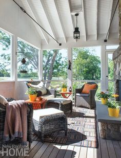 A sunny screened-in porch is cooled by Cape Cod breezes and scattered with comfy chairs atop a Stark area rug. Porch Chairs, White Dining Room Chairs, Desk Chairs, New England Homes, New Homes, Cape Cod, Closed In Porch, Mid Century Modern Sideboard, House With Porch