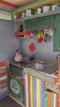 camper kitchenette bright and colourful recycled wood unusual camper van interiors mobile vintage clothes shop unusual camper van horse box conversion www.crystalvintage.co.uk www.crystalvintage.co.uk https://twitter.com/GloriaPopUpShop Gloria, the Crystal vintage dressing up box, as seen on George Clarke's Amazing Spaces series 2, ep 4 channel4