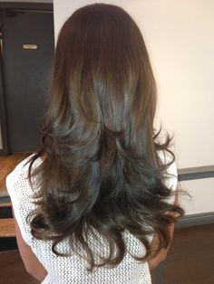 Love the color and the cut...wish I could get my hair that long!
