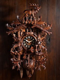 Ornately carved cuckoo clock.