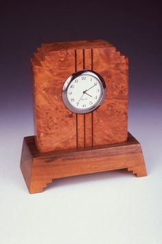 Howard Griffiths - Maple Burl & Walnut Side Step Desk Clock Howard Griffiths desk accessories make a wonderful addition to any desk. This beautiful Maple Burl with Walnut base Desk Clock measures 4.25
