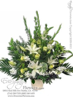 Green And White Funeral Flowers Delivery by Everyday Flowers