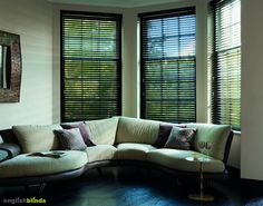 Black wooden blinds in a contemporary sitting room.