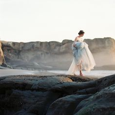 Runaway bride   Visual writing prompt and photography inspiration for female character inspiration   Lady in white escaping by the sea   Book writing ideas, fantasy and romance book prompts