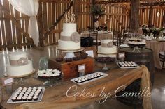 Vintage, rustic wedding cake dessert table Cakes accented with burlap flowers with antique brooche centers