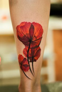 http://tattoomagz.com/red-tattoo-pictures/red-tattoo-calf/ I love that you can see the light through the petals!