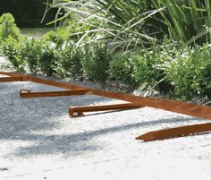 This garden edging can create beautiful curves for that perfectly manicured gravel path or can simply define your lawn and garden. Landscape Edging, Garden Edging, Lawn And Garden, Gravel Path, Beautiful Curves, Easy Install, Recycled Materials, Outdoor Furniture, Outdoor Decor
