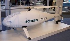 Produced by the Austrian company Schiebel, it was developed from 2003 to 2005. With a maximum take-off weight (MTOW) of 200 kilograms (440 lb), its endurance is 6 hours. It has a maximum speed of 220 kilometres per hour (140 mph) and a ceiling of 5,500 metres (18,000 ft). It is powered by a 55 horsepower (41 kW) Diamond engine and can carry various payloads, such as electro-optics and infrared sensors.