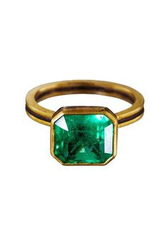 An antique-inspired emerald engagement ring  | Brides.com