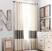 Cut drapes and put a panel of fabric between them.