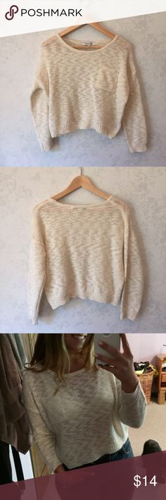 """Gold & Cream Crop Loose knit Sweater with Pocket L Cream Sweater with metallic thread running through it.  Very loose open knit.  Pocket on the front. 3/4 sleeve Cropped Across chest - 27"""" Overall length - 20"""" Sleeve length - 17.5""""  Excellent very gently used condition.  Clean smoke free home Forever 21 Sweaters"""