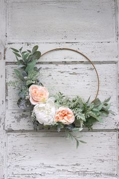 An Easy DIY Spring Hoop Wreath Make an easy spring hoop wreath using greens and faux flowers. Just tie and glue the stems in place to create a beautiful wreath for any time of year. Diy Spring Wreath, Diy Wreath, Tulle Wreath, Winter Wreaths, Burlap Wreaths, Wreath Ideas, Holiday Wreaths, Spring Crafts, Faux Flowers