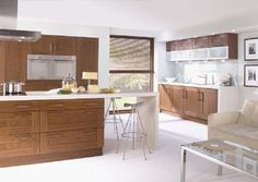 natural warm wood  and stainless steel - contemporary walnut shaker kitchen - Quality Kitchens of Stamford. I like the paneling cabinetry but in white.