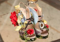 Nicholas Kirkwood designed these kooky heels titled Alice In Wonderland for the exhibition Read more: http://www.dailymail.co.uk/femail/article-2057905/These-shoes-arent-walking-The-incredible-inch-heels-sore-toes.html#ixzz1crMC6iLH