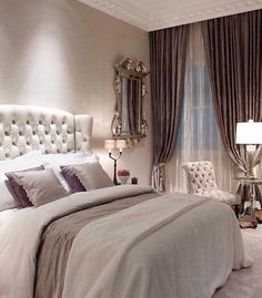White Tufted wingback headboard- dark purple curtains over white shimmery sheers