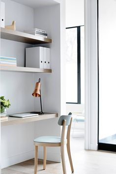 Floating desk and shelves that make for the perfect office space! Love!