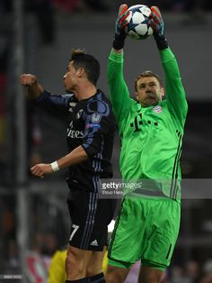 Manuel Neuer of Bayern Muenchen and Cristiano Ronaldo of Real Madrid compete for the ball during the UEFA Champions League Quarter Final first leg match between FC Bayern Muenchen and Real Madrid CF at Allianz Arena on April 12, 2017 in Munich, Germany. (Photo by Etsuo Hara/Getty Images)