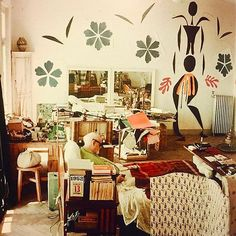 """Matisse in his studio at the Hotel Regina"""