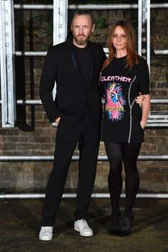 British fashion designer Stella McCartney (R) poses with her husband Alasdhair Willis (L) arriving for the presentation of her menswear launch and women's Spring 2017 collection presentation in London on November 10, 2016.  / AFP / BEN STANSALL