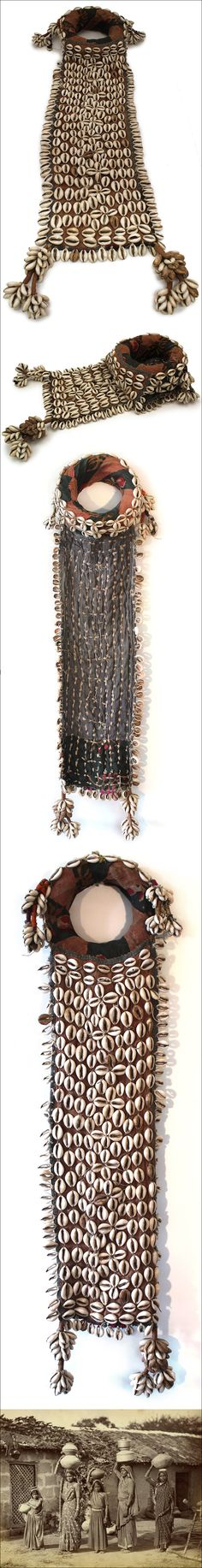 Headdress, Banjara, Gujarat, India.  This is a beautiful example of Banjara headgear with a pot-ring for stabilizing the water jar and an very long panel with hundreds of cowrie shells that hangs down to protects a Banjara woman's back from splashing water. Cowries are very auspicious as they represent Lakshmi, the goddess of prosperity.