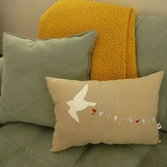 I dig the clever applique on this pillow.