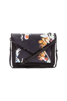795e85918993 Mini-Bags are turning up the heat for summer! Carry this Hawaiian print