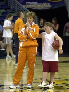 Lady Vols coach Pat Summitt stands with her son, Tyler,