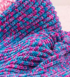 Free knitting pattern for One Row Baby Blanket super easy pattern - It doesn't get any easier than this baby blanket from Red Heart by Nancy J. Thomas. You just knit one row over and over to make a beautiful blanket. Great with multi-color yarn!