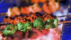 Turmeric and chili marinated chicken drumsticks, green herbs marinated chicken tikka, curry leaf masala marinated local white fish and tomatoes, black pepper and garlic prawns, mini lamb kofta kebabs.