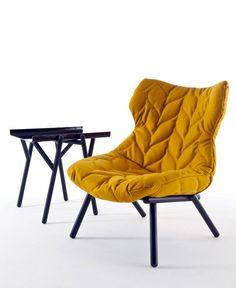 Patricia Uruquiola armchair with topstitching covering the entire surface including the back to make the most of the aesthetic effect.