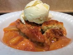 Over at Julie's: Crusty Peachy Peach Cobbler ~ Tender, juicy, cinnamon laced, peaches topped with a crunchy sweet biscuit topping . . . Yum!
