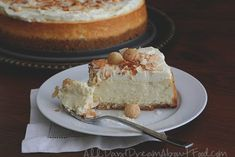 A slice of low carb coconut cheesecake on a round white dessert plate with a fork full of cheesecake on the plate Low Carb Cheesecake Recipe, Coconut Cheesecake, Coconut Desserts, Sugar Free Desserts, Coconut Recipes, Sugar Free Recipes, Baking Recipes, Keto Recipes, Low Carb Sweets