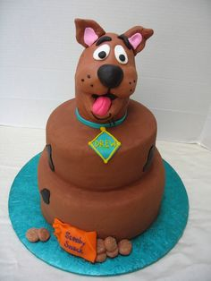 Scooby Drew! Scooby's head is made of rkt covered in MMF. Cake is iced in chocolate butter cream.