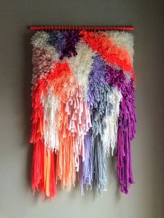 This colorful tapestry was delicately hand woven with a bunch of wool, cotton and silk threads and some satin ribbons. It was done in smoke-free home.  Hand-painted and varnished wood stick in neon coral.  It measures 20 inches width x 34 inches long [51x 86 cm] Check other tapestries in my shop!!! https://www.etsy.com/shop/jujujust?section_id=13455358  Check my policies and shippping: https://www.etsy.com/shop/jujujust/policy?ref=shopinfo_policies_leftnav   © Judit Just 2014-2016