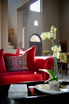 Pretty red velvet with Moroccan touches - lounge, open plan kitchen