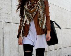 Brown leather jacket, white shirt, navajo scarf.  Little black coconut style