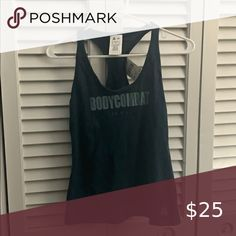 """Reebok """"Bodycombat les mills"""" Tank Top, with tags Blue/Green tank top, Brand new from Reebok, size Reebok Tops Tank Tops Les Mills, Green Tank Top, Reebok, Top Colour, Blue Green, Athletic Tank Tops, Brand New, Tags, Things To Sell"""