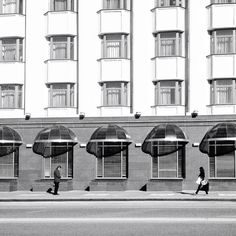 Two by codesweeper, via Flickr | black white grey + street scene people + architecture + iphoneography