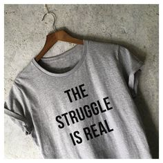 The Struggle Is Real Shirt for Women in Grey Meme T-Shirts Tumblr... (€17) ❤ liked on Polyvore featuring tops, t-shirts, grey, women's clothing, form fitting tops, form fitting t shirts, gray shirt, hipster t shirts and gray top