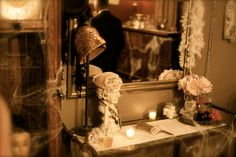 This is a picture of the the vanity table I set up as decoration for my Great Gatsby Halloween Party.