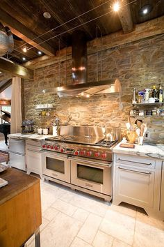 Kitchen:Rustic Kitchen With Stone Wall Also Reclaimed Wood Ceiling,  Stainless Steel Hood,