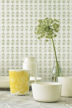 A delicate, small scale flower motif wallpaper design by Marimekko perfect for a subtle background design.