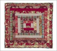 this would be a lovely christmas quilt...plaids and sophisticated christmas fabrics