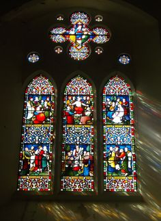 A stunning stained glass window from St Mary and St Peter's Church, East Sussex, England. By B Lowe