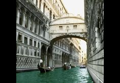 Bridge of Sighs, Venice.  With its carved white limestone suspended above the canal, the Ponte dei Sospiri inspires wistful exhalations from visitors. The 1602 bridge takes its name from the sad sighs of the condemed peering from its barred windows as they were marched from the Doge's Palace to prison.