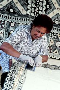 Women wear Tapa Cloth on special occasions. This woman is creating a Tapa cloth special to her family.
