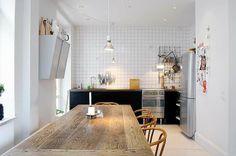 Kitchen design love - Table, tiles, lamp, black cupboards, worktop, chairs....